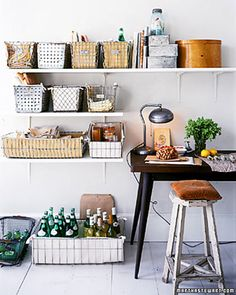 Coordinated Containers  Metal baskets once used for milk bottles and other groceries make perfect storage units for the kitchen. For maximum impact, choose similar containers, but vary their sizes and shapes (the metal ones here feature punched holes and wire grids). Line baskets with canvas, and group them together to organize an entire roomful of odds and ends.