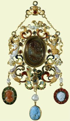 Pendant jewel with Apollo and Daphne. 2nd half 16th c. with 18th c. additions. A sard cameo representing a bearded male head, in profile to the right; with surrounding open scrollwork frame set with seven table-cut diamonds and two rubies and incorporating: to the left, a reclining figure of Cupid; to the right, Apollo with Cupid in flight above and a dragon flanked by two harpy terms below. Three pendants are suspended from the jewel.