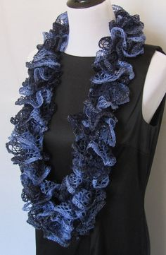Hand knitted womens ruffle scarf in dark navy blue and light blue with a silver thread along the edge that makes it sparkle. #handmade #etsyretwt