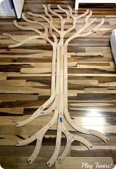 "Tree Track: Learning About Trees with Wooden Train Tracks @ Play Trains! http://play-trains.com/ The Little Engineer, at 2.5 years old, was enthralled with the whole process for a good hour and a half, and learning about art, biology, and planning and executing a project the whole time! Based on the art installation, ""Tree Track"", by Christien Meindertsma."