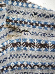Knitting & Crochet Guild cardigan close-up of damaged sleeve