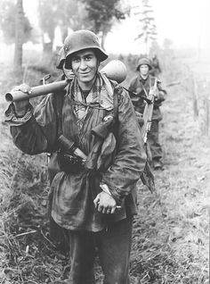 A German grenadier armed with a Panzerfaust 60, hand grenades and the Walther G-41 semi-auto rifle. The G-41 was a late attempt to replace some, at least, of the bolt-action rifles in the German forces, but the effort run into technical difficulties and the G-41 (and G-46) never gained any serious traction.