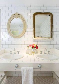 A great new take on his and her sinks. It clean, love the mirrors, and simple