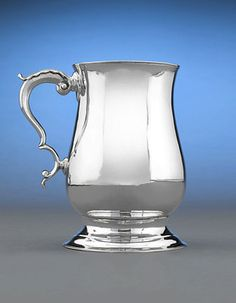 This exquisite Georgian silver mug by the renowned Hester Bateman boasts a straightforward elegance.