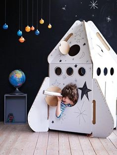"How to Build a Cardboard Rocket Ship: My son asked Santa for a ""real rocket ship"" this Christmas to take the family to the moon. Santa has trouble getting rocket fuel this time of year so this is how I built a cardboard rocket. Cardboard Rocket, Cardboard Toys, Cardboard Spaceship, Cardboard Playhouse, Cardboard Furniture, Bed Furniture, Cardboard Design, Fireplace Furniture, Furniture Ideas"