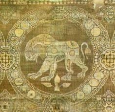 Lion. Purple silk serge. From the tomb of St. Julian in Rimini. Byzantine, 9th -10th century, based on a Sassanian original. (Museo Nazionale, Ravenna.)