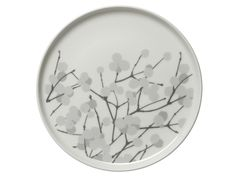 Marimekko Lumimarja White/Grey Plate This small plate makes a sweet statement and act as the perfect complement to winter weather. With Erja Hirvi's snowberry print stretching across the ceramic face of the Marimekko Lumimarja White/Grey .