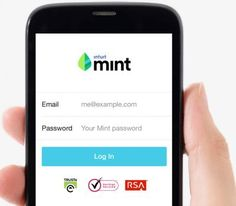 hand holding a smart phone showing Mint's login screen