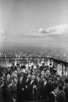 Russian head Nikita S. Khrushchev and his wife, center, meet the press at the top of the Empire State building in September 1959