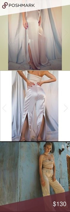 """The Line By K beige satin pants size Medium Crafted from luxurious rayon-satin, these wide-leg pants are slit through the back for a cool draped shape. Button, hook and eye, and concealed fastening at front. Wear with our Izzy tube top and some strappy sandals for a romantic dinner!  - Inseam 35""""  - 100% rayon, non-stretchy fabric  - Runs true to size, take your normal size  - Model is 5'7 32-24-34 and wears size small - this one for sale is a size medium - runs true to size   - Dry clean…"""