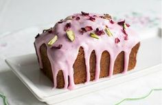 Rosewater drizzle cake is light and elegant, but very simple to make and topped with pretty icing, pistachios and edible rose petals for a beautiful bake