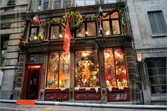 Street scene in Vieux Montreal - Old Montreal featuring a storefront of Christmas decorations.