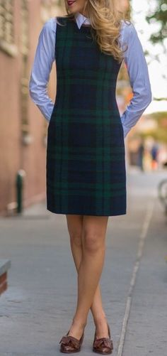 Preppy school girl-inspired outfit: plaid jumper with button-down underneath and bow flats