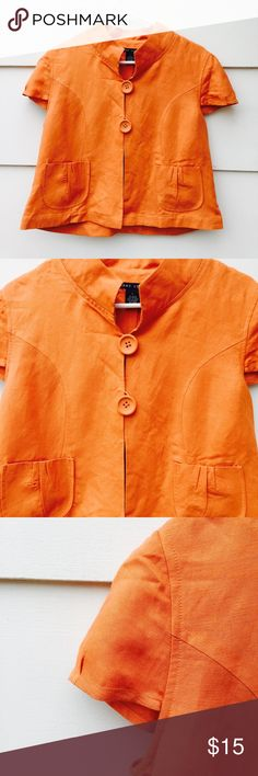"""Larry Levine Women's Career Top Blouse #002 Lovely Larry Levine womens career top orange blouse 2 front big buttons puff short sleeves 55% linen 45% rayon. Size: L Measurement: sleeves 5 1/2"""" shoulder 16"""" armpit 42"""" overall length 20"""" Condition: Pre-owned, some wrinkling, in good condition. Larry Levine Tops Blouses"""