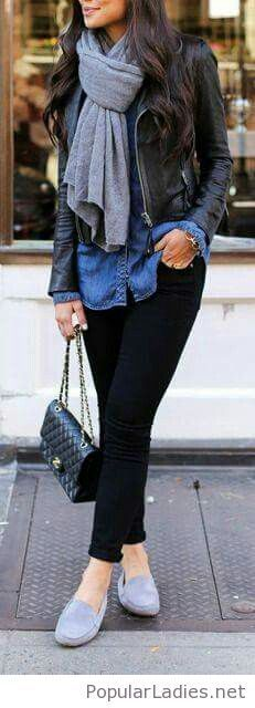 Black pants, blue jean shirt and a leather jacket
