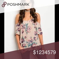 Floral Cold Shoulder Blouse Beautiful light weight cold shoulder blouse. Has a beautiful floral design. Has a small opening in the front with buttons and a cross cross opening in the back. These blouses are true to size. Same day shipping on purchases made before 2 PM PST Tops Blouses
