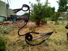 Ugly bird metal garden sculpture