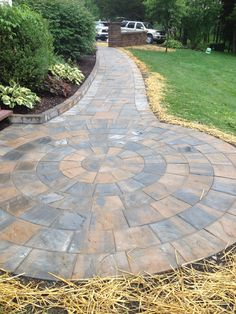 Walkway done with cambridge Pavers ledgestone   xl toffy onyx light,  circle kit and ledgestone wall used as border stand up.  To check more go to http://www.aztlanlc.com