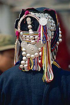 Silver and beads on an Aini Hani hat at Menghai, Yunnan China