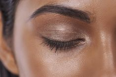 Arched brow shape + subtle shimmery shadow
