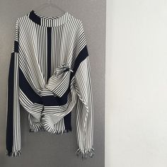Sweatshirt in blue/white stripes - tie detail in front and fringed edges