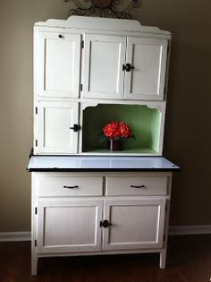 We Have This Hoosier Cabinet With Red Trim Around The Porcelain Shelf.