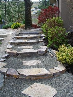 Stairway along narrow part of property : Snake River flagstone steps and path in Kelowna installed by Lush Mountain landscape and design