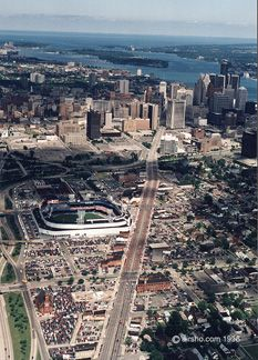 Tiger Stadium - Opening day, looking east. In the background is the RenCen (tallest building on right) bought by GM to become their new world headquarters. Belle Isle, the Detroit River, and Lake St. Clair are beyond.