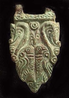 Viking bronze buckle, ca. 6th-10th century AD. The buckle with twin dragon heads above twin birds, an additional head between the two dragons, and another at the ...
