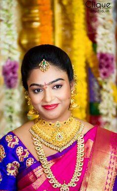 South Indian bride. Temple Indian bridal jewelry. Jhumkis.Pink silk kanchipuram sari with contrast blue blouse.Braid with fresh jasmine flowers. Tamil bride. Telugu bride. Kannada bride. Hindu bride. Malayalee bride.Kerala bride.South Indian wedding.