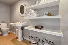 Narrow bathroom with open shelving and wire baskets