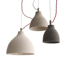 The Heavy Light collection includes four sizes of pendants, a wall and a desk light and and offer a fresh perspective on concrete- usually considered an industrial material- and challenge perceptions of its use within domestic and commercial environments. Produced in four tonal finishes, each concrete shade is individually slip-cast and left inverted in the mould to dry for a number of days. During this process, random air pockets and veining develop on the interior of the shade. Thes...