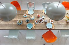 Rustic table with colorful chairs