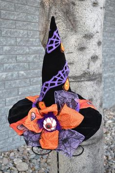 All eyes will be on you with this playful black velvet witch hat that's uniquely embellished with purple and orange spiderweb ribbons and a giant eyeball. Witch Party, Halloween Witch Hat, Halloween Goodies, Halloween Trees, Halloween Projects, Holidays Halloween, Happy Halloween, Halloween Decorations, Origami Halloween