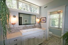 Bathroom with transom window above mirror