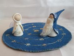 Advent Calendar centerpiece with embroidered star spiral and Waldorf inspired angel pegdoll OR Winter gnome. Round, delicately embroidered felt Advent calendar with 24 different stars connected to form a spiral for a Waldorf inspired, embroidered angel pegdoll or Winter gome to walk