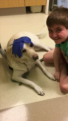 Poor Oprah! This dog will tolerate anything if it gives joy and comfort to her boy....the long hospital day was probably the hardest on her!