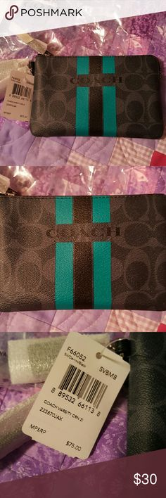 Coach varsity corner sm wristlet Brand new still with tags on it small corner wristlet dark navy black and Teal I  took it  out of package for pictures  only measures 6 long by 4 inches high super cute coach Bags Clutches & Wristlets