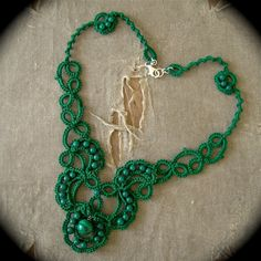 Made with mountain jade beads a malachite bead and green thread.
