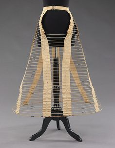 The cage crinoline created the fullness of skirts during the crinoline era. The skirt is made from hoops of steel and whale bone. The cage was adjustable and light weight; therefore, people claimed it was much healthier than contraptions of the past. This American crinoline was made around 1870. The materials that were used were linen, metal, and leather.