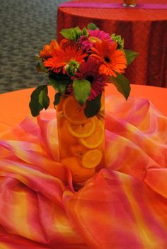 Love the bright orange tablecloths!