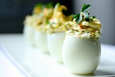Deviled eggs with bacon and cheddar. Hands down the best recipe EVER.   www.feastingathome.com