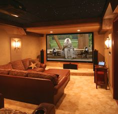Awesome couch and projector for basement home theatre For the