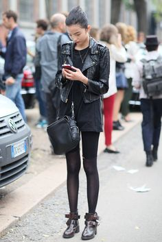Milan Fashion Week Street Style Spring 2013 - is that ostrich leather jacket? And her ankle boots are muy cute