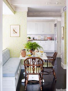 In the breakfast area of this New York City apartment, Windsor chairs take on a new life with citrus-green cushions. Designer Ashley Whittaker cut down a Ballard Designs Berkley Trestle table and spray-painted it white. Wallpaper is Baldwin Bamboo by Scalamandré.   - HouseBeautiful.com