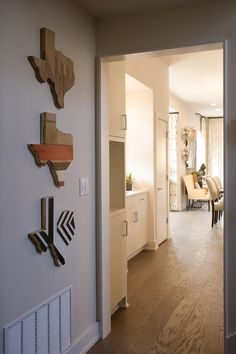 A triad of decorated wooden Texas plaques serve as a focal point at the base of the stairwell and pay homage to the Lone Star State.