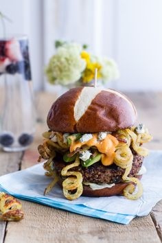 This black bean patty is topped with cheese sauce and curly fries for one whimsical burger. Get the recipe from Half Baked Harvest.   - Delish.com