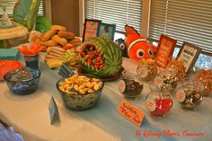 A Disney Mom's Thoughts: Finding Nemo First Birthday Party Food, Sub sandwiches, pasta salad, fruit bowl, goldfish bar and Nemo gummy snacks!