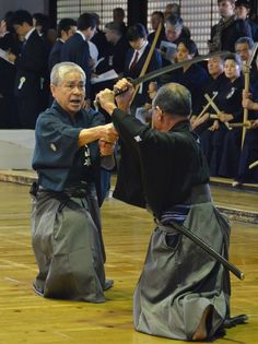 """Iaido is usually thought of as a solo art, but it contains many partner kata. Here, the kneeling forms of Musō Jikiden Eishin-ryū are demonstrated, part of a set known as """"Tsumi Ai no Kurai""""."""