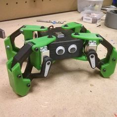 Kame is a quadruped robotic platform fully 3d printed, developed on the BQ innovation lab. It is programmed with Arduino and powered by an ESP8266. It has full mobility, and capabilities for performing different movements like jumping, dancing...  This project has born with the aim of studying different gaits and algorithms for generating them. It has been designed entirely on FreeCAD an printed with an open-source 3D printer.